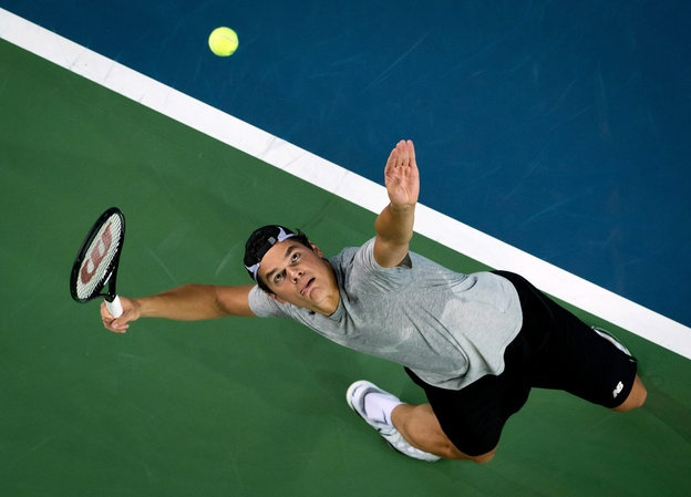 Canada's Milos Raonic works on his serve while practicing for a Davis Cup tennis quarterfinal tie against Italy in Vancouver, British Columbia, on Tuesday, April 2, 2013. The match begins on Friday. (AP Photo/The Canadian Press, Darryl Dyck)