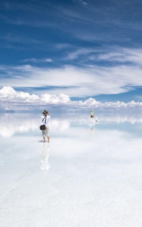 Salar de Uyuni is a magical place: When covered by water, the world's largest salt flat becomes a mirror, and anyone walking across it appears to be walking on clouds.