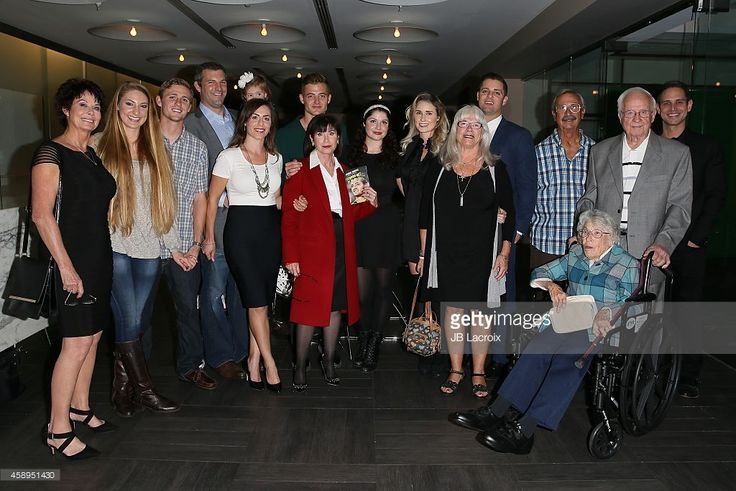 Robbie Rogers (center) and his family attend the release of his memoir 'Coming Out To Play' on November 13, 2014 in West Hollywood, California.