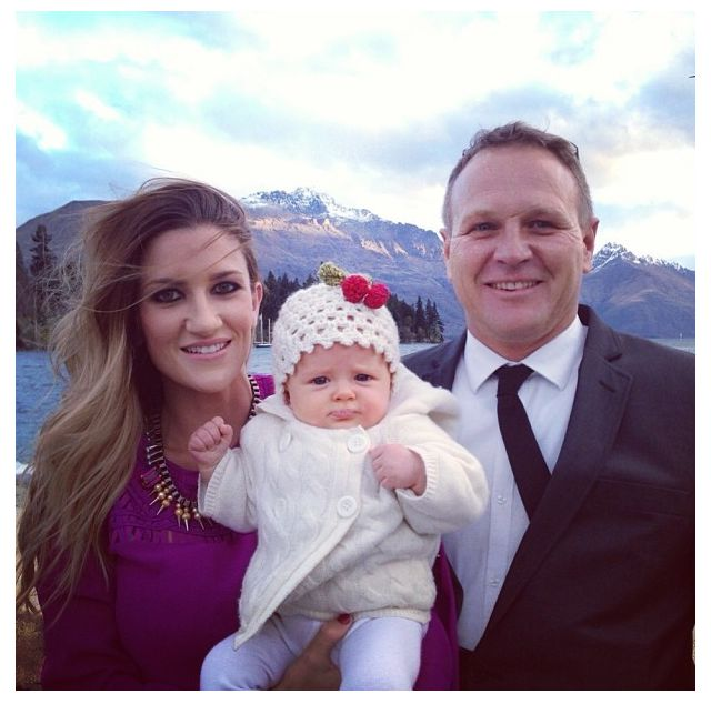 Michaela Byrnes wearing her olympia necklace at a wedding in New Zealand. Pictured here with her partner and baby girl Maya. Gorgeous!