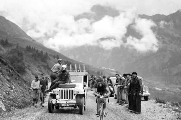 """Ferdinand """"Ferdi"""" Kubler riding uphill during a breakaway in the 16th stage of the Tour de France between Cannes and Briançon on July 18, 1949. -AFP Read more at http://www.thestar.com.my/sport/cycling/2016/12/31/swiss-champion-kubler-dies-age-97/#S1FBIKiYXTOUm1Z4.99"""