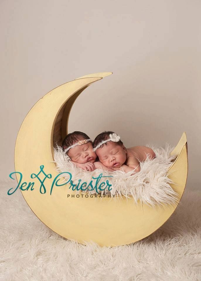 Twins on moon prop newborn baby