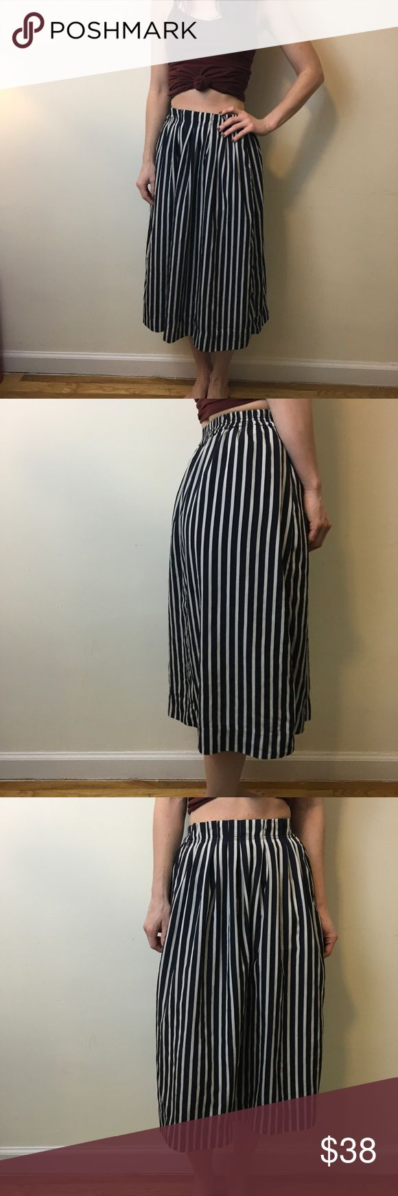 J. Crew Navy & Cream Striped Midi Skirt J. Crew Midi Skirt with a striped body and an elastic waist. Is lined and is a size 0. Worn only once no flaws! J. Crew Skirts Midi