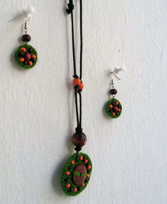 Hand knitted green-orange necklace-earring set by KirkeCraft