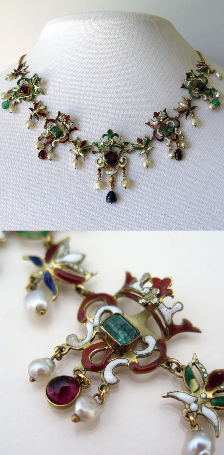 """Antique Victorian 18k Gold Austro Hungarian Emerald Garnet Enamel Necklace. This necklace has a Neo-Renaissance Revival design and made in Austro Hungary during the 1880's. There are five """"crown"""" pendants. The drops at the bottom dangle freely giving the necklace a delicate amount of movement when worn. The stones are closed back foiled and colored to enhance the gemstones vibrancy and color. The clasp is with its original safety latch."""
