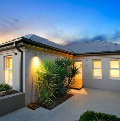 facade, landscaped gardens, welcoming home