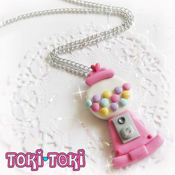 ♥ This cute gumball machine is designed and hand-sculpted by me using polymer clay. It features a kawaii pink gumball machine with pastel colors gumballs, accented with glitter, and a cute baby pink organza bow (optional). This kitschy necklace is mounted on a high-quality silver plated chain. ♥ Every piece of my work is completely handmade with love and attention to details. You will never find two items that will ever be exact, so each piece is completely unique and special! ♥ Please…