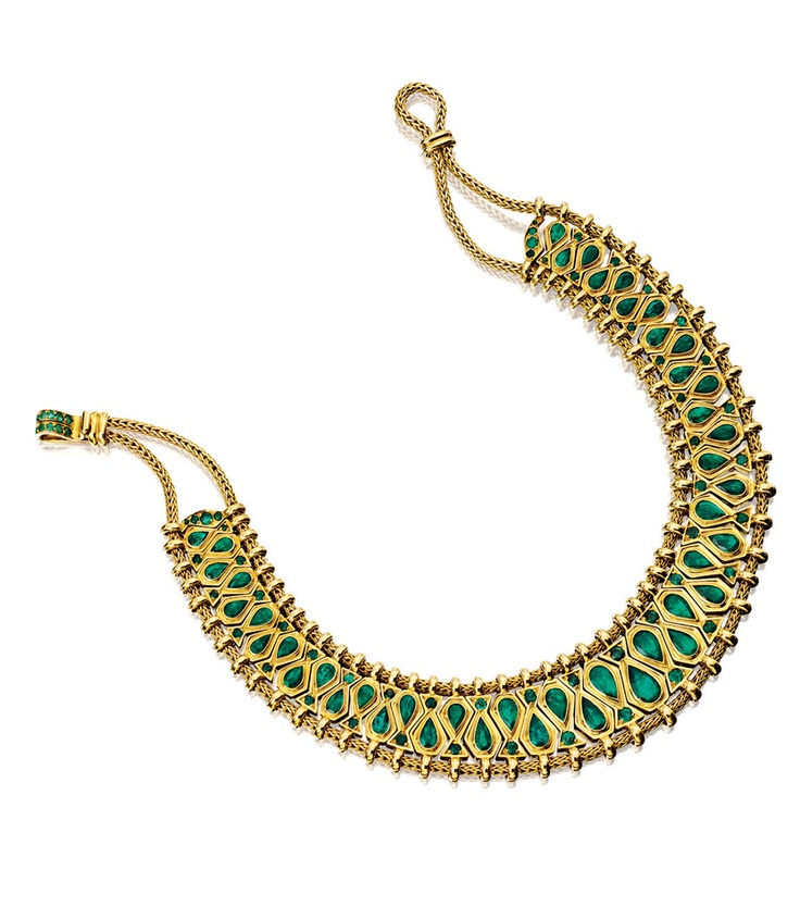 GOLD AND EMERALD 'HINDOU' NECKLACE, RENÉ BOIVIN, 1950S. Designed as a series of graduated geometric links set with pear-shaped and circular-cut emeralds, between woven gold cords, to a similarly set clasp, French assay marks, unsigned.
