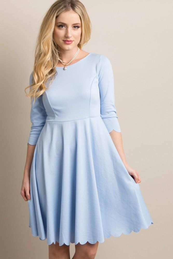 6858c2af4a3c2 A solid dress featuring a scalloped hemline and 3/4 sleeves, cinched  waistline, a princess style stitching on bust, and a rounded neckline.