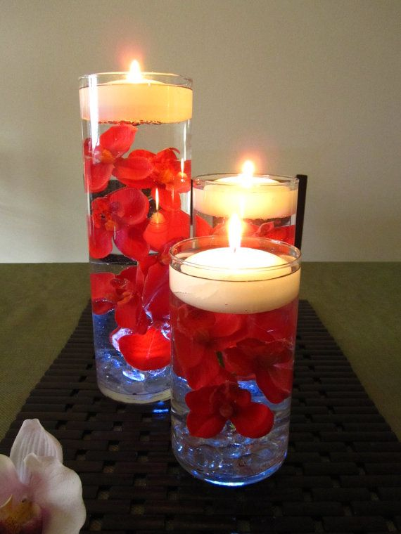 it cost under $20. Glass vases (set of 3) from Ikea, candles and glass stones from the dollar store, silk flowers from dollar store or Michaels.