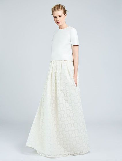 From Max Mara Bridal Collection… Two-piece dress with a boxy short-sleeve top in double duchesse and silk blend, and a long romantic organza skirt, decorated with milk-white polka-dot embroidery. Photo Max Mara