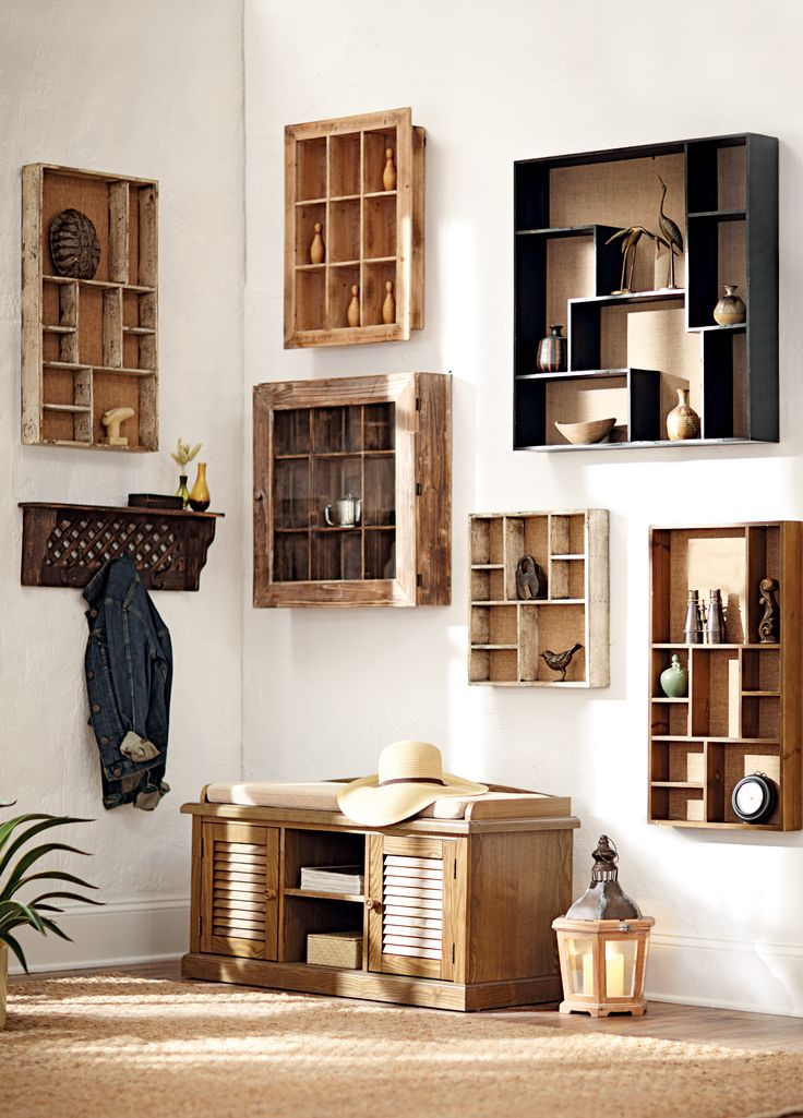 Shelves display family holiday photos, hold small gifts from friends and good books to name a few. HomeDecorators.com #12DaysofDeals #storage #organization