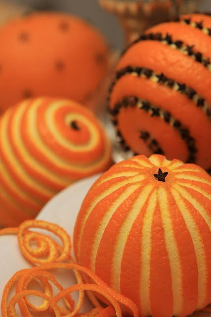 """Charming oranges. Cut out the pattern in oranges and place them on a platter along with """"strips"""". Garnish with cloves."""