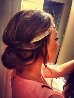 Summer bun hairstyle updo with headband.