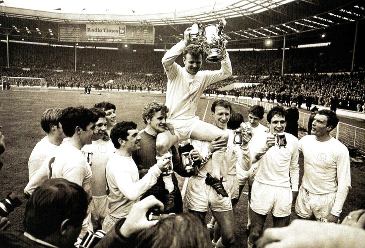 Leeds United captain Billy Bremner holds the League Cup aloft as his team-mates carry him on their shoulders after their win against Arsenal - UK - 2 March 1968