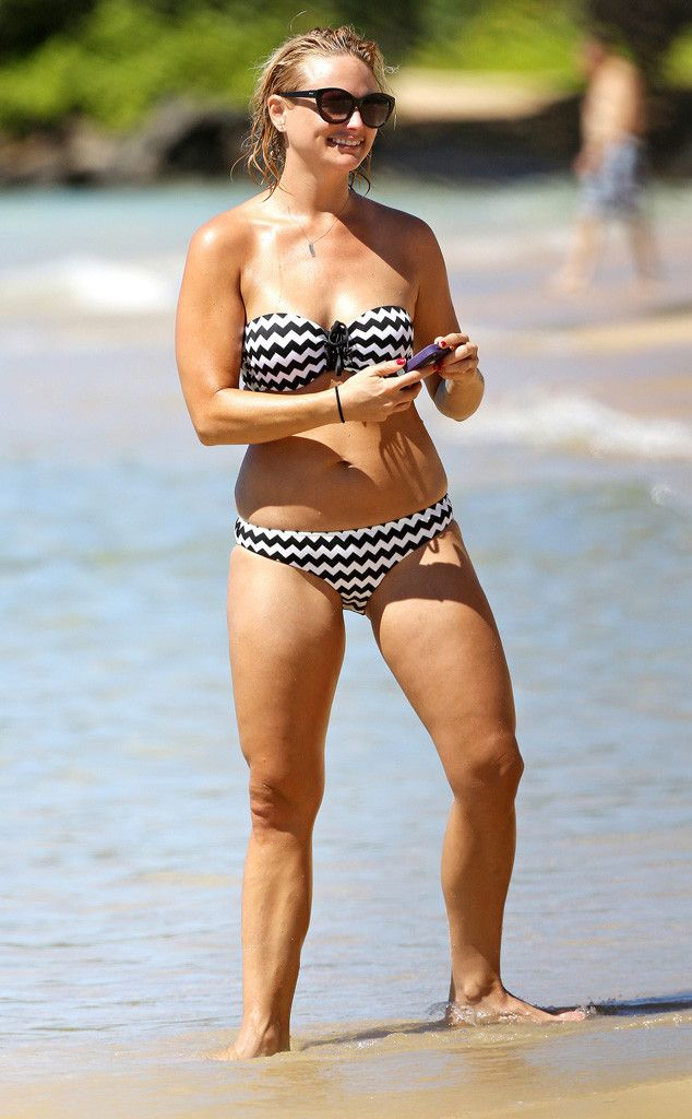 All that hard work is paying off! Miranda Lambert flaunts her fit figure in a tiny two-piece.