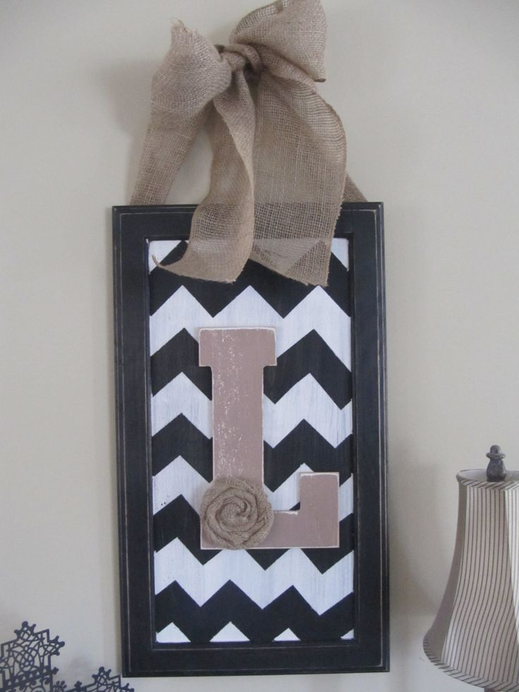Chevron sign with customized letter from repurposed wood cabinet door. $45.00, via Etsy.