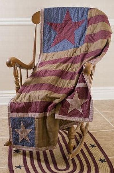 July-4th-perfect Americana quilt displayed on a wooden rocker with an Americana rug beneath)!