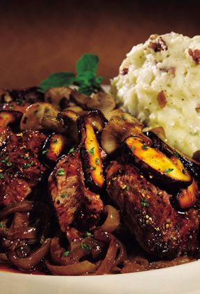 The Cheesecake Factory - Steak Diane - Medallions of Certified Angus Beef Steak Covered with Black Peppercorns and a Rich Mushroom Wine Sauce. Served with Mashed Potatoes and Grilled Onions.