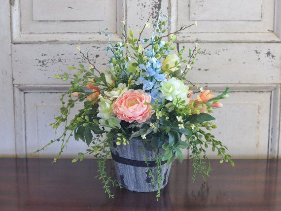 Check out this lovely spring table arrangement at https://www.etsy.com/listing/269978513/spring-silk-flower-arrangement-roses