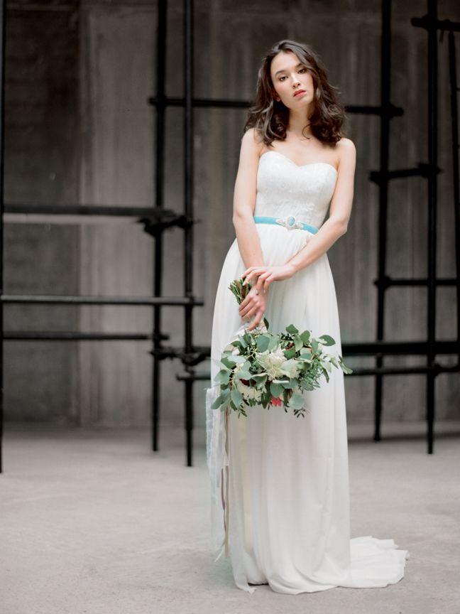 Something blue. Wedding dress with blue ribbon sash by Milamira // Elegant Wedding Gown Inspiration
