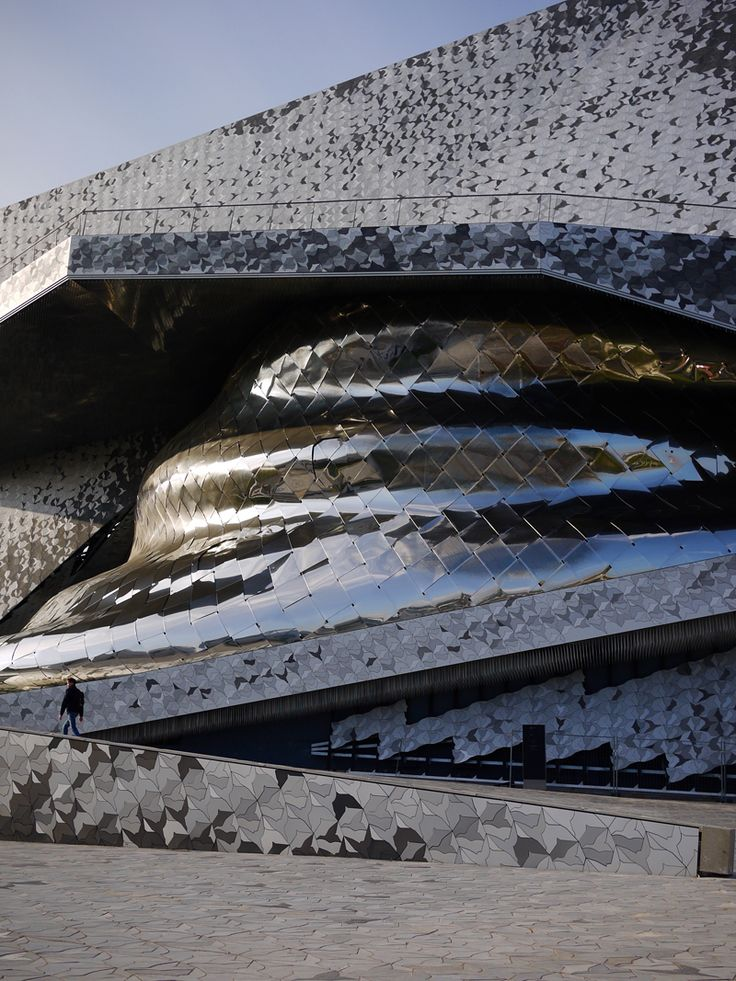 Silver dragon is resting.This fanciful building - Philharmonie de Paris. The facade of this building changes color, like dragon scales changes depending on lighting. The diversity of this building is striking, from different angles you will see differen…