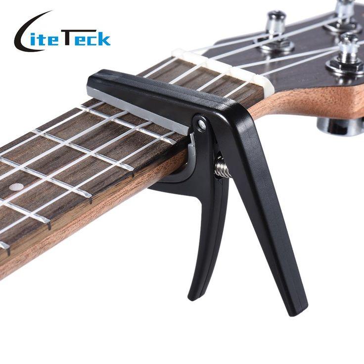 Aliexpress.com: Comprar Profesional Ukelele Ukelele Capo Single handed Cambio Rápido Capo Plástico Acero Negro Guitar Parts & Accessories de accessories quinny fiable proveedores en LiteTeck