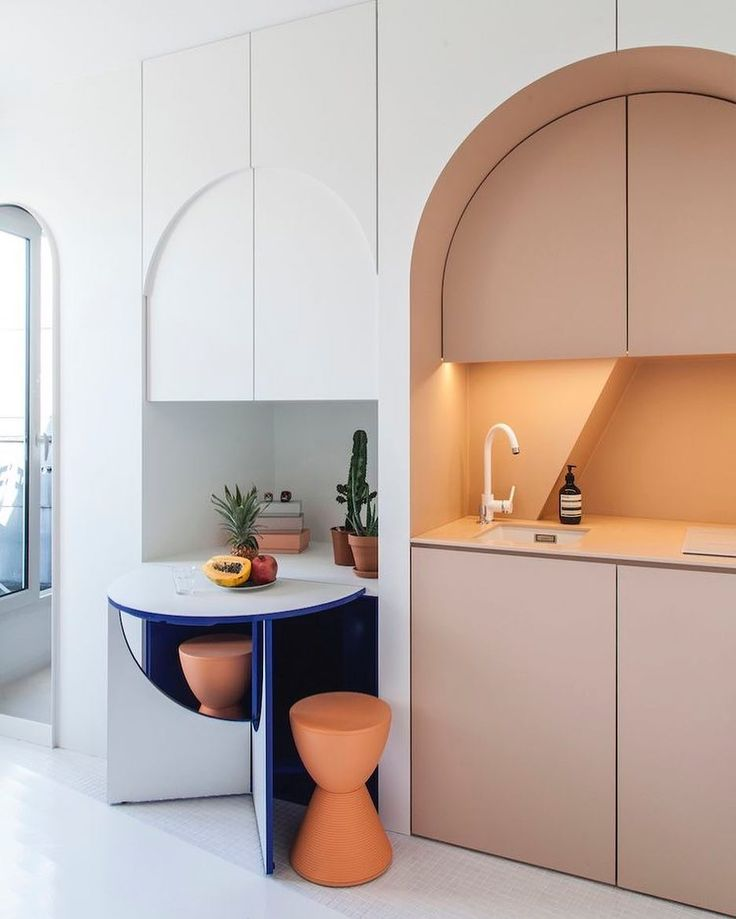 _ _ Interior Inspiration _ Small apartment in Paris by Batiik Studio @batiikstudio  _ As I was scouring the infinite world of Pinterest for inspiration for a school project I'm working on I came across this wonderful little kitchen design for an apartment in Paris (only but my favourite city in the whole world)! The blush! The arches! The hidden pops of blue! _ School design aside this kitchen has got me thinking a lot about how when you take small design risks in your home like adding…