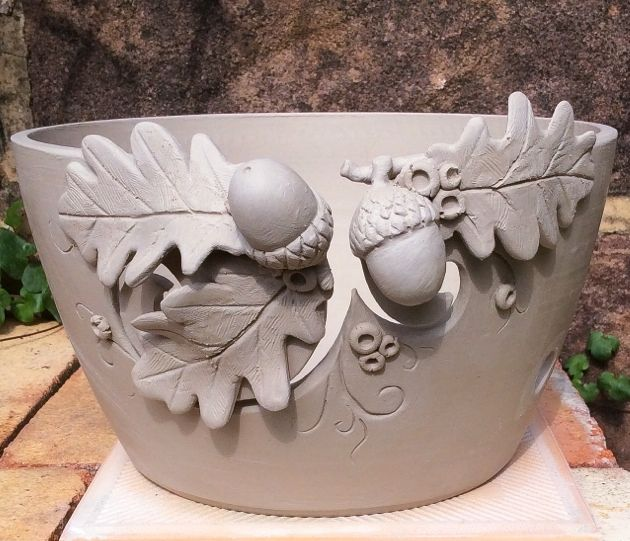 Unfired 'Acorns and Oak leaves' yarn bowl. Fired and glazed in two weeks. Further pics to follow.