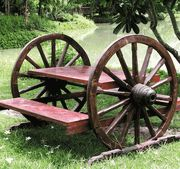 LOVE this picnic table!!! If its actually on an axle it would move easy for mowing or whatever!
