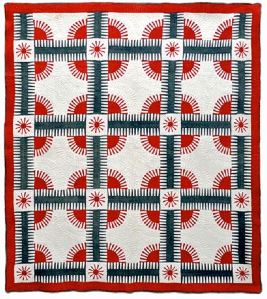 antique New York Beauty quilt featured on Sue Garman blog - has strips instead of points