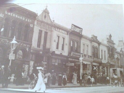 Rundle street. Year unknown. The lady in white is in front of a millinery shop owned by Dan Chappell.