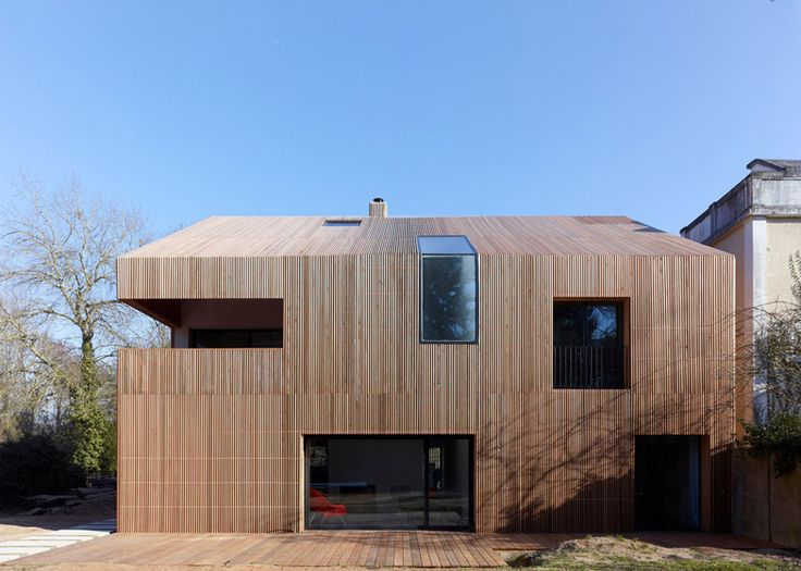 French studio Avenier & Cornejo Architectes has usedstrips of cedar cladding to wrap every surface of this house in Orsay, France