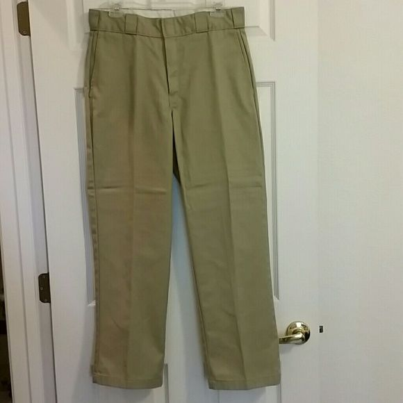2 pairs of Men's khaki pants 2 pairs of men's khaki Dickies pants. Only worn a couple times. Great condition!  $15 for both pairs or $10 each. Dickies Pants