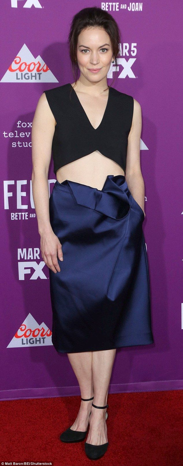 Interesting outfit: Actress Britt Lower dared to bare in a tiny black sleeveless crop top ...