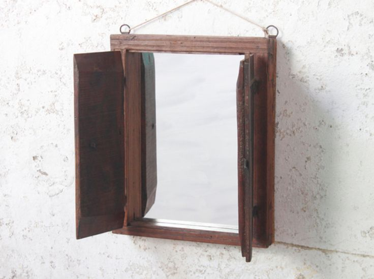 A beautiful teak wall mirror with shutters crafted from a reclaimed antique window frame. #vintage #mirror #unique #furniture #homedecor #homestyle