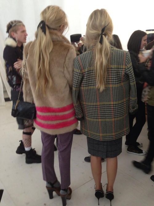 Model Laura Bailey and stylist Martha Ward with flowing blond locks caught up with ribbon.