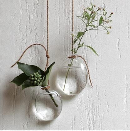 Hanging Vases by Jurgen Lehl: Available in a number of shapes, these hang from rope handmade from the bark of the Japanese lime tree. #Vase #Hanging_Vase #Jurgen_Lehl #remodelista
