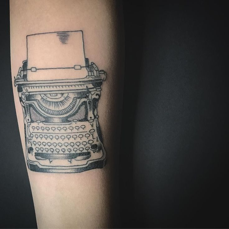 Cute type writer tattoo on the forearm that almost look like sticker.