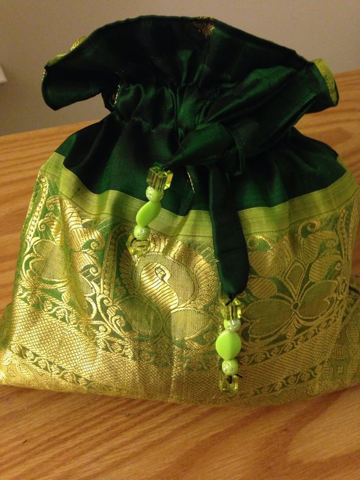 SOLD: Reusing Indian saris to make potli bags used for giving gifts for birthdays house warming or can be  used to store jewelry, toys...