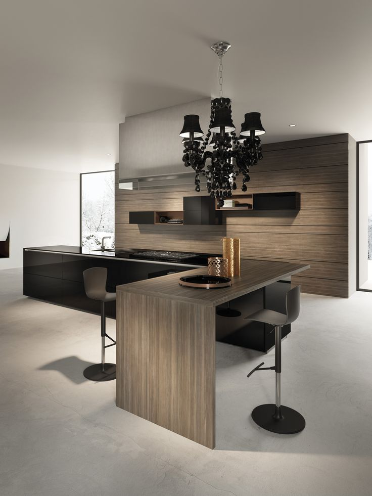 Modular kitchen composition with liquid metal lacquered finishes.