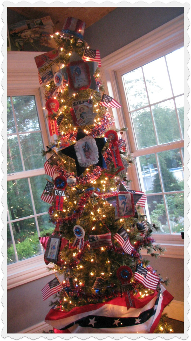 We have a year-round tree in our sunroom that gets holiday makeovers.  This is my patriotic tree.  A glittered top hat is the tree top this year.