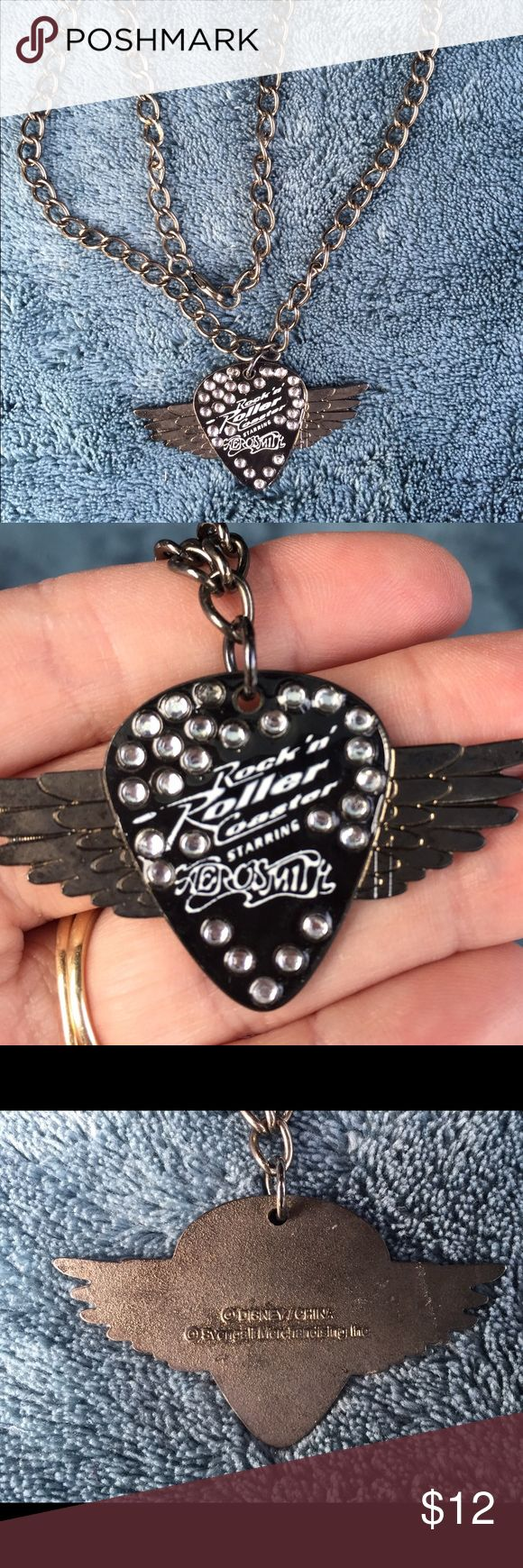Rock n roller - Aerosmith guitar pick necklace Can't get to Hollywood Studios in Florida? Are you a huge Aerosmith fan? Then you will love this guitar pick necklace!! In excellent condition. It was loving adored having hung on my daughters pegboard for a few years after her 1st ride on rock n roller coaster over 10 years ago! Disney Jewelry Necklaces