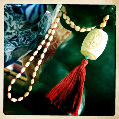 """Red Tassel"" Necklace  Bone pendant white glass beads, coral, turquoise, red cotton tassel"