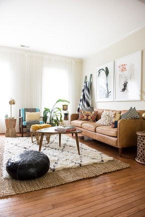 Bohemian living space with a camel leather sofa and a shag rug