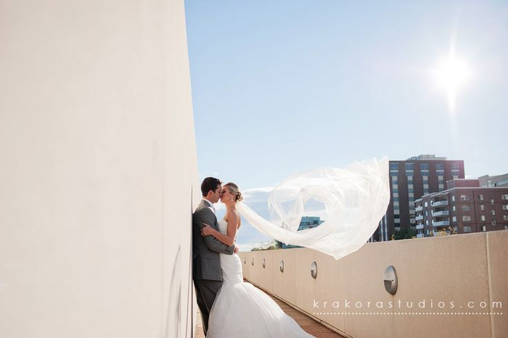 Carly and Jeff spend their wedding day capturing memories at Monona Terrace. Sun is shining and love is in the air! Photo taken by: Krakora Studios