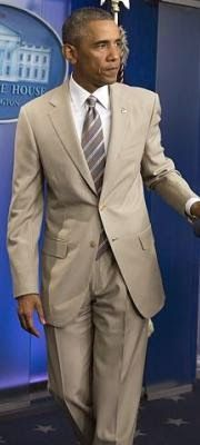 Barack Obama's tan suit sparks uproar on Twitter....My President is so friggin handsome!
