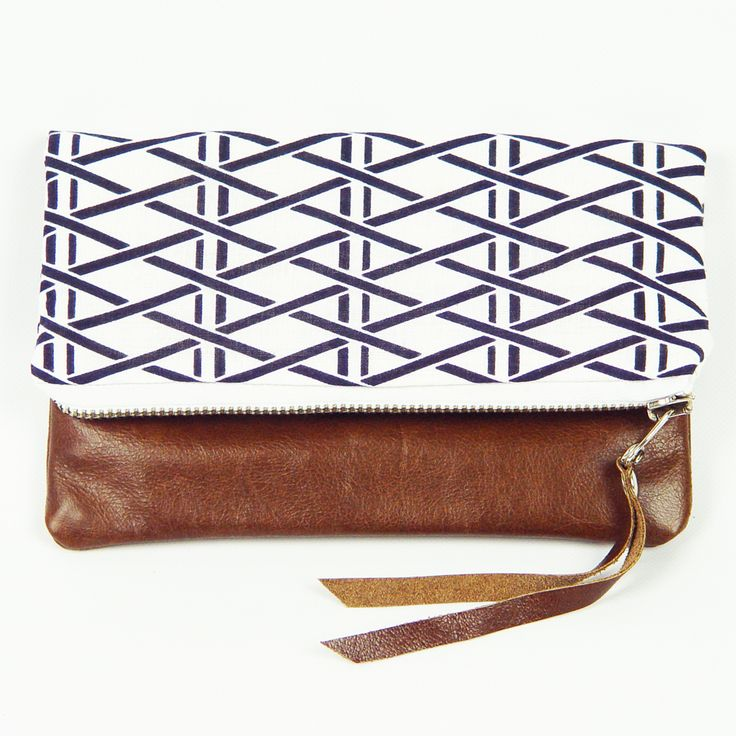 Handmade from vintage kimono fabric and cow hide. (http://www.ifoundlove.com.au/vintage-kimono-clutch-geometric-diamonds/)