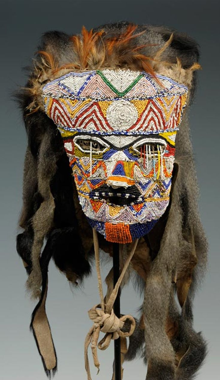 Africa | Beaded face mask from the Tabwa people of DR Congo | Glass beads, fur, monkey hair, cloth and feathers | Mid 20th century