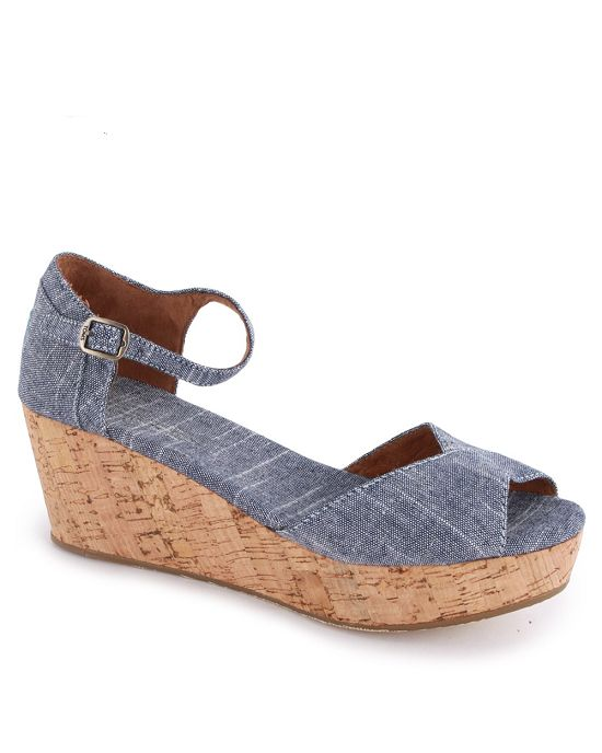 "- Denim - rubber sole - Platform measures approximately 1.00"" - Vegan - no animal by-products - Wedge - Adjustable ankle strap with buckle closure Size Chart: About Brand: In 2006, American traveler B"